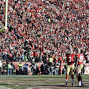 In front of a packed house at Candlestick Park, San Francisco 49ers quarterback Colin Kaepernick (7) greets 49ers tight end Vernon Davis (85) after Kaepernick passed to Davis for a touchdown against the Seattle Seahawks in the first half of an NFL footbal