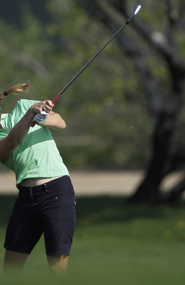Charley Hull of England plays a ball on the 9th hole during the 2nd round of Dubai Ladies Masters golf tournament in Dubai, United Arab Emirates, Thursday, Dec. 5, 2013