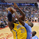 Indiana Pacers center Ian Mahinmi, left, of France, has his shot blocked by Los Angeles Clippers forward Antawn Jamison during the second half of an NBA basketball game, Sunday, Dec. 1, 2013, in Los Angeles The Associated Press