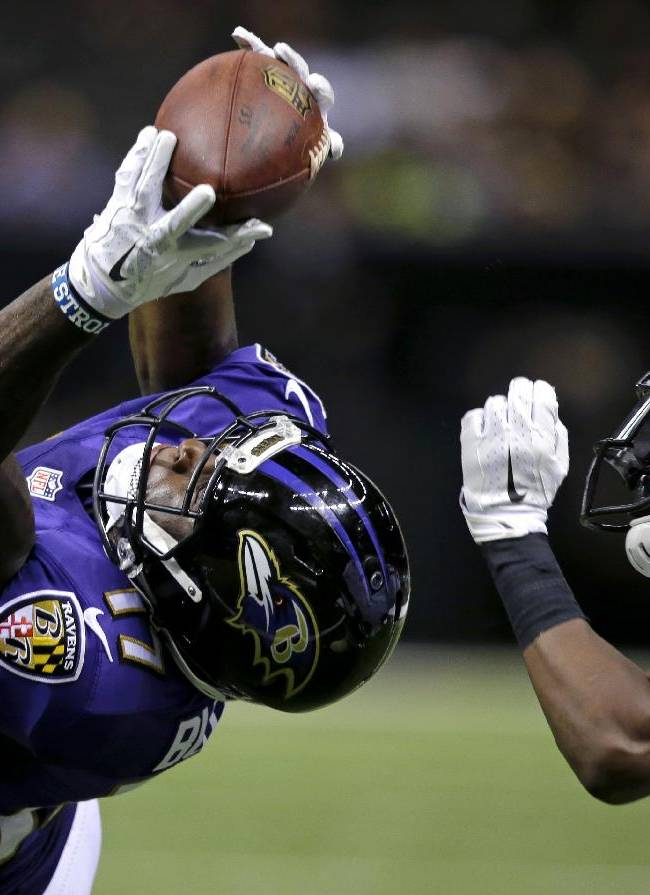 10ThingstoSeeSports - Baltimore Ravens wide receiver Jeremy Butler (17) tries to pull in a pass over New Orleans Saints defensive back Terrence Frederick during the second half of an NFL preseason football game in New Orleans, Thursday, Aug. 28, 2014