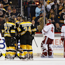 Boston Bruins defenseman Zdeno Chara, center, of Slovakia is congratulated by teammates Loui Eriksson (21) of Sweden and Carl Soderberg (34) of Sweden after scoring as Phoenix Coyotes' Derek Morris (53), Keith Yandle (3) and goalie Mike Smith skate away d