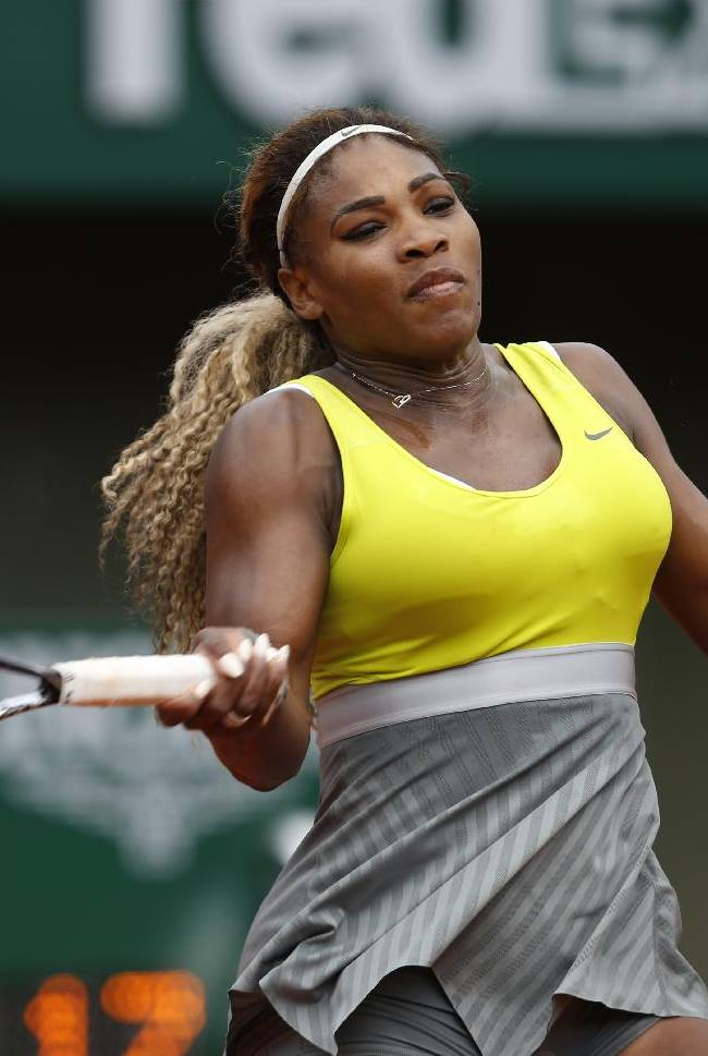 Serena Williams of the U.S, returns the ball to France's Alize Lim during the first round match of  the French Open tennis tournament at the Roland Garros stadium, in Paris, France, Sunday, May 25, 2014. Williams won 6-2, 6-1