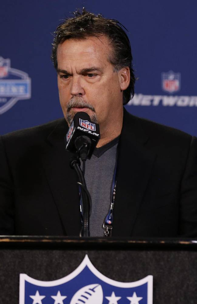 St. Louis Rams head coach Jeff Fisher answers a question during a news conference at the NFL football scouting combine in Indianapolis, Friday, Feb. 21, 2014