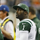 New York Jets quarterback Michael Vick looks from the sidelines during the second half of an NFL football game against the Buffalo Bills in Detroit, Monday, Nov.24, 2014 The Associated Press