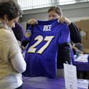 A worker folds up a former Baltimore Ravens running back Ray Rice jersey that a fan traded in, Friday, Sept. 19, 2014, at M&T Bank Stadium in Baltimore. The Ravens offered fans a chance to exchange their Rice jerseys for those of another player after he was cut by the team and suspended indefinitely by the NFL for domestic violence. (AP Photo/Patrick Semansky)