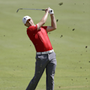 Jordan Spieth hits off the first fairway during the final round of play in the Tour Championship golf tournament at East Lake Golf Club, in Atlanta, Sunday, Sept. 22, 2013. (AP Photo/John Bazemore)