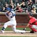 New York Mets Collin Cowgill hits a two-run single in the fourth inning of a baseball game against the Washington Nationals in New York on Saturday, April 20, 2013. Washington Nationals catcher Kurt Suzuki works behind the plate
