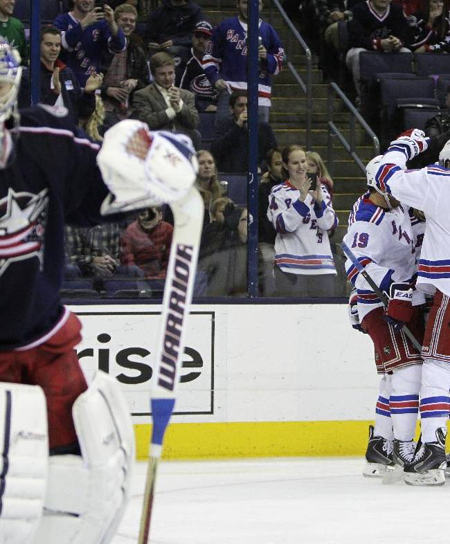 New York Rangers' players celebrate their goal against Columbus Blue Jackets' Sergei Bobrovsky, of Russia, during the first period of an NHL hockey game Thursday, Nov. 7, 2013, in Columbus, Ohio