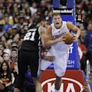 Los Angeles Clippers' Blake Griffin, right, is fouled by San Antonio Spurs' Tim Duncan during the first half of an NBA basketball game on Monday, Dec. 16, 2013, in Los Angeles. (AP Photo/Jae C. Hong)