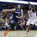 Charlotte Bobcats' Josh McRoberts (11) drives past Cleveland Cavaliers' Tristan Thompson (13), from Canada, during the first quarter of an NBA basketball game Friday, Nov. 15, 2013, in Cleveland The Associated Press