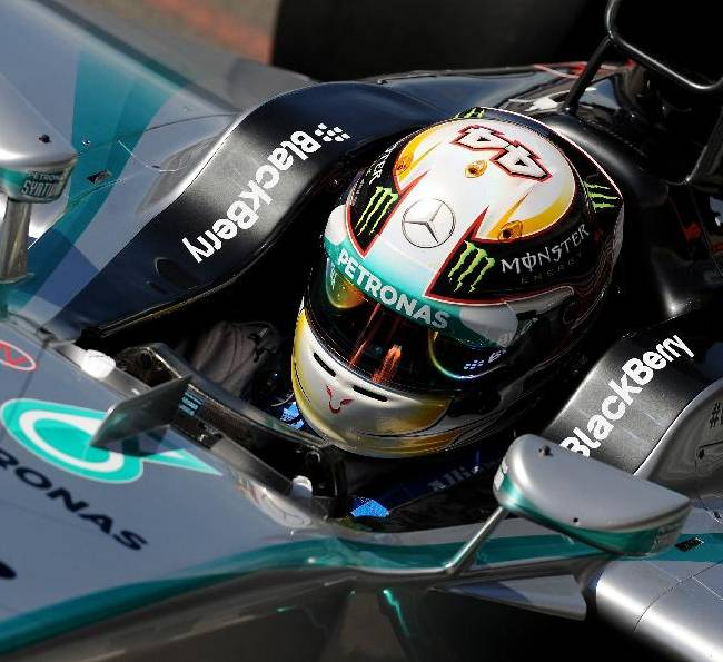 Britain's Lewis Hamilton of Mercedes drives his car in the pits during a practice session in Silverstone, England, on Friday, July 4, 2014, ahead of this weekend's Formula One British Grand Prix. Hamilton's car ground to a halt with 30 of the 90 minutes remaining. The British Formula One Grand Prix will be held on Sunday July 6, 2014