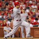 Cincinnati Reds' Todd Frazier follows through on a two-run home run during the fourth inning of a baseball game against the St. Louis Cardinals, Tuesday, Aug. 19, 2014, in St. Louis. (AP Photo/Scott Kane)