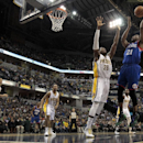 Philadelphia 76ers forward Thaddeus Young (21) shoots over Indiana Pacers center Ian Mahinmi (28) during the first half of an NBA basketball game in Indianapolis, Monday, March 17, 2014 The Associated Press