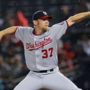 Washington Nationals starting pitcher Stephen Strasburg (37) delivers in the fifthinning of a baseball game against the Atlanta Braves Monday, Sept. 15, 2014, in Atlanta. (AP Photo/Todd Kirkland)