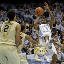 North Carolina's Dexter Strickland (1) shoots as Wake Forest's Devin Thomas (2) and Madison Jones defend during the first half of an NCAA college basketball game in Chapel Hill, N.C., Tuesday, Feb. 5, 2013. (AP Photo/Gerry Broome)