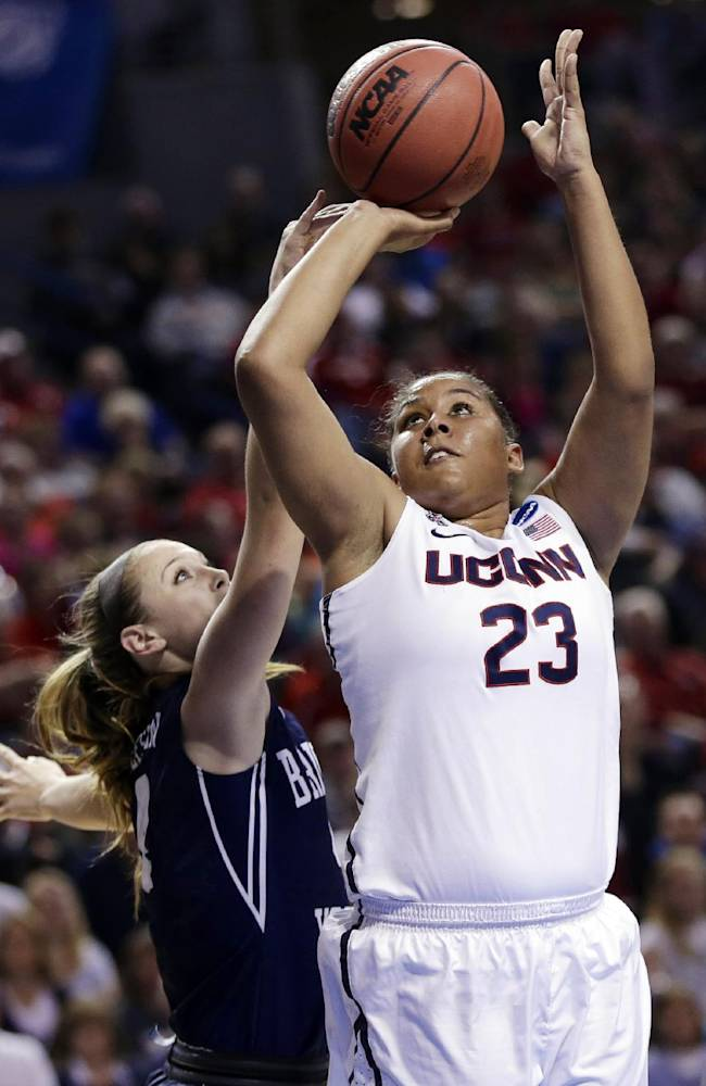 Connecticut's Kaleena Mosqueda-Lewis (23) shoots past BYU's Kim Beeston (4) during the first half of a regional semifinal in the NCAA college basketball tournament in Lincoln, Neb., Saturday, March 29, 2014
