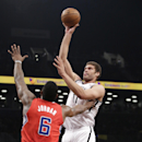 Brooklyn Nets center Brook Lopez, right, shoots over Los Angeles Clippers center DeAndre Jordan (6) in the first half of an NBA basketball game at the Barclays Center, Thursday, Dec. 12, 2013, in New York. Lopez had 16 points in the Nets' 102-93 victory o