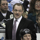 Pittsburgh Penguins head coach Dan Bylsma talks to an official from the bench in the second period of an NHL hockey game against the Edmonton Oilers, Sunday, March 13, 2011, in Pittsburgh. The Penguins won 5-1. (AP Photo/Keith Srakocic)