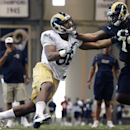 Rams defensive end Michael Sam, left, and offensive lineman Greg Robinson practice during the first day of NFL football training camp for rookies on Tuesday, July 22, 2014, at Rams Park in Earth City, Mo The Associated Press