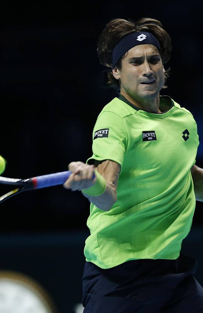 David Ferrer of Spain plays a return to Tomas Berdych of Czech Republic during their ATP World Tour Finals single tennis match at the O2 Arena in London Wednesday, Nov. 6, 2013
