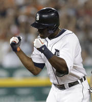 Detroit Tigers' Torii Hunter celebrates after hitting a two-run double against the Minnesota Twins in the seventh inning of a baseball game in Detroit, Wednesday, Aug. 21, 2013. (AP Photo/Paul Sancya)