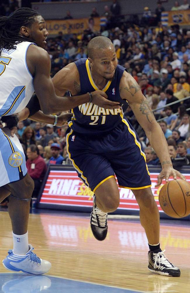 Indiana Pacers power forward David West (21) drives around Denver Nuggets power forward Kenneth Faried (35) during the third quarter of an NBA basketball game Saturday, Jan. 25, 2014, in Denver