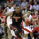 Louisville guard Russ Smith (2) heads down the court ahead of Western Kentucky players in the second half of an NCAA college basketball game on Saturday, Dec. 22, 2012, in Nashville, Tenn. Smith led Louisville with 20 points as they won 78-55. (AP Photo/Mark Humphrey)