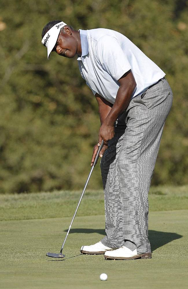 Vijay Singh putts on the 18th green during the third round of the Frys.com Open golf tournament, Saturday, Oct. 12, 2013, in San Martin, Calif
