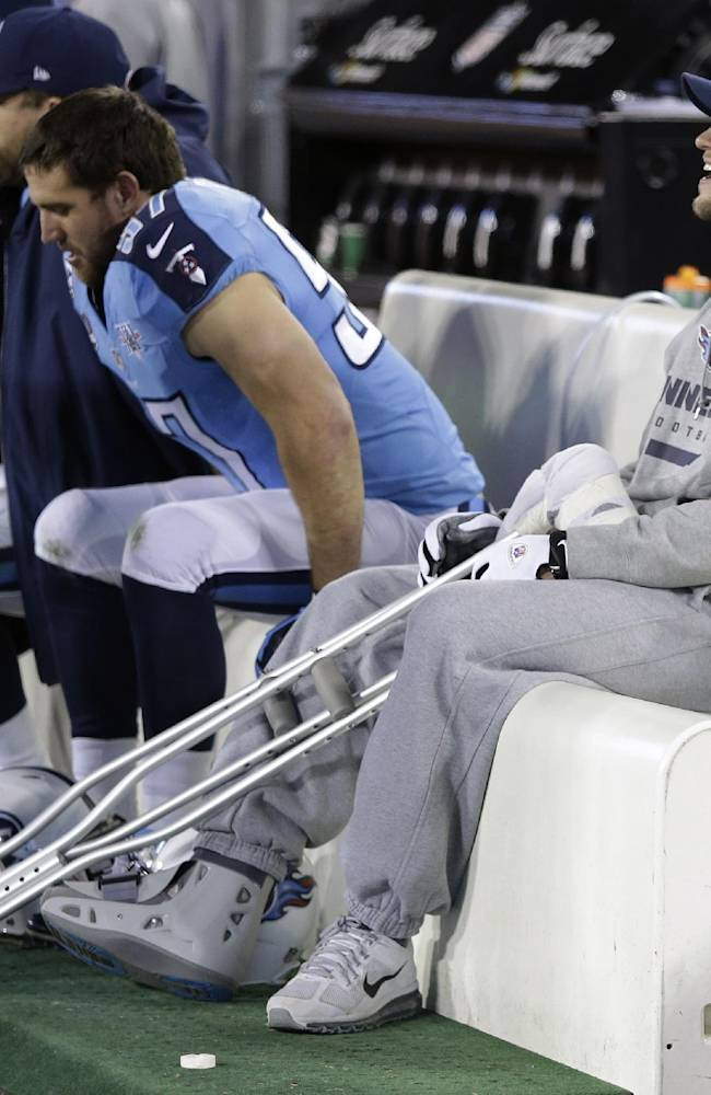 Injured Tennessee Titans quarterback Jake Locker sits on the bench in the second quarter of an NFL football game between the Titans and the Indianapolis Colts on Thursday, Nov. 14, 2013, in Nashville, Tenn