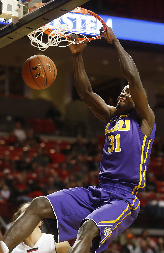 LSU's John Odo dunks over Texas Tech's Dusty Hannahs during an NCAA college basketball game in Lubbock, Texas, Wednesday Dec. 18, 2013