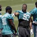 Suh finding his way with Dolphins, on and off the field The Associated Press