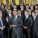 President Barack Obama talks with members of the Sporting Kansas City soccer team during a ceremony in the East Room of the White House in Washington, Wednesday, Oct. 1, 2014, where he honored the 2013 Major League Soccer champions The Associated Press