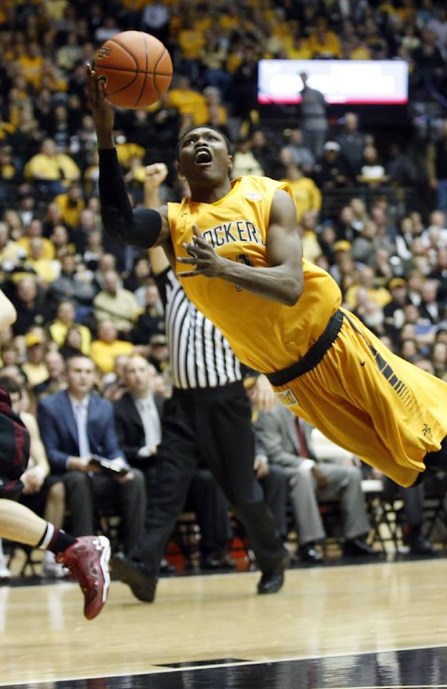 Wichita State's Cleanthony Early shoots the ball while falling to the floor against Southern Illinois during the first half of an NCAA college basketball game Tuesday, Feb. 11, 2014, in Wichita, Kan