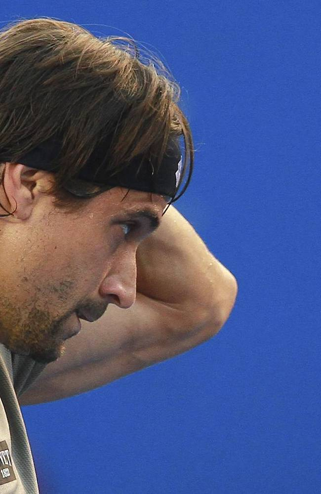 Spain's David Ferrer pauses during a match of the Mexican Tennis Open championship against Russia's Mikhail Kukushkin in Acapulco, Mexico, Tuesday Feb. 25, 2014
