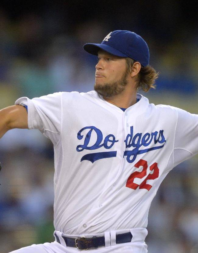 In this Aug. 27, 2013, file photo, Los Angeles Dodgers starting pitcher Clayton Kershaw throws to the plate during the first inning of a baseball game against the Chicago Cubs in Los Angeles. Kershaw won the National League Cy Young Award, Wednesday, Nov. 13, 2013