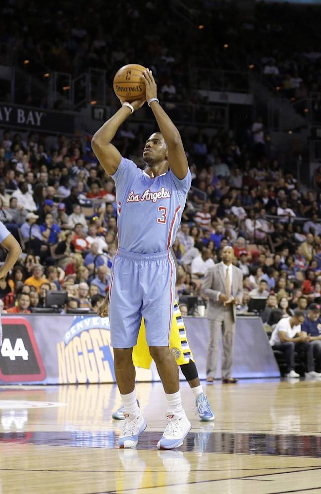 The Los Angeles Clippers' Chris Paul shoots a free throw during the first half of a preseason NBA basketball game against the Denver Nuggets on Saturday, Oct. 19, 2013, in Las Vegas