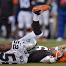 Cleveland Browns quarterback Brian Hoyer is hit by Oakland Raiders linebacker Khalil Mack (52) after throwing an incomplete pass in the third quarter of an NFL football game, Sunday, Oct. 26, 2014, in Cleveland The Associated Press