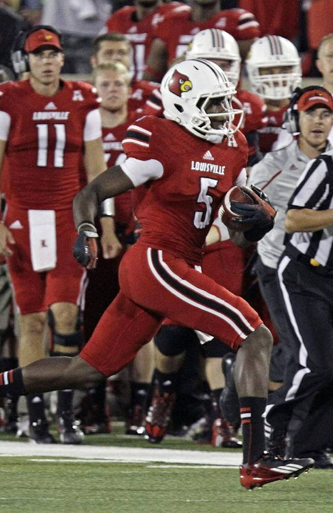Louisville quarterback Teddy Bridgewater runs during the first half of an NCAA college football game against Rutgers in Louisville, Ky., Thursday, Oct. 10, 2013