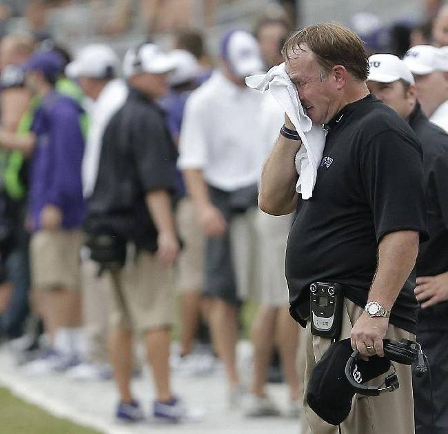 In this Sept. 28, 2013 file photo, TCU head coach Gary Patterson, black shirt, wipes his face during the second half of an NCAA college football game against SMU in Fort Worth, Texas. The Horned Frogs are most definitely in unfamiliar territory entering year three as a member of the Big 12. Since the move the Frogs are 11-14, 6-12 in conference and it's been one thing after another for Patterson
