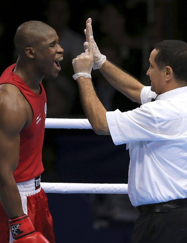 South Africa's Siphiwe Lusizi reacts to receiving a standing count from the referee during the Men's middleweight quarterfinal against Northern Ireland's Connor Coyle during the 2014 Commonwealth Games in Glasgow, Scotland, Wednesday July 30, 2014