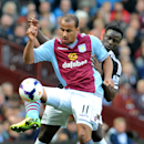 Aston Villa's Gabriel Agbonlahor, left, shields the ball from Southampton's Victor Wanyama during the English Premier League soccer match between Aston Villa and Southampton at Villa Park, in Birmingham, England, Saturday, April 19, 2014