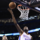 Oklahoma City Thunder forward Kevin Durant (35) shoots in front of Memphis Grizzlies center Marc Gasol (33) and Memphis Grizzlies guard Tony Allen (9) during the fourth quarter of Game 1 of the opening-round NBA basketball playoff series in Oklahoma City