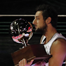 Marco Belinelli of the San Antonio Spurs holds a trophy after he won the three-point contest during the skills competition at the NBA All Star basketball game, Saturday, Feb. 15, 2014, in New Orleans The Associated Press