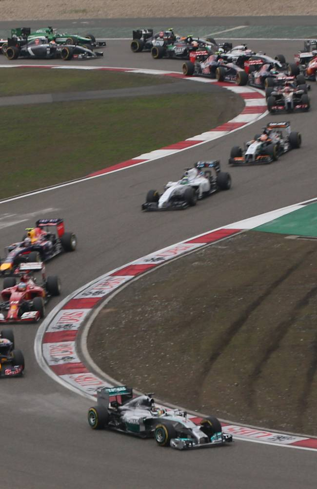 Mercedes driver Lewis Hamilton of Britain leads the field into turn three at the start of the Chinese Formula One Grand Prix at Shanghai International Circuit in Shanghai, Sunday, April 20, 2014. (AP Photo/Eugene Hoshiko)