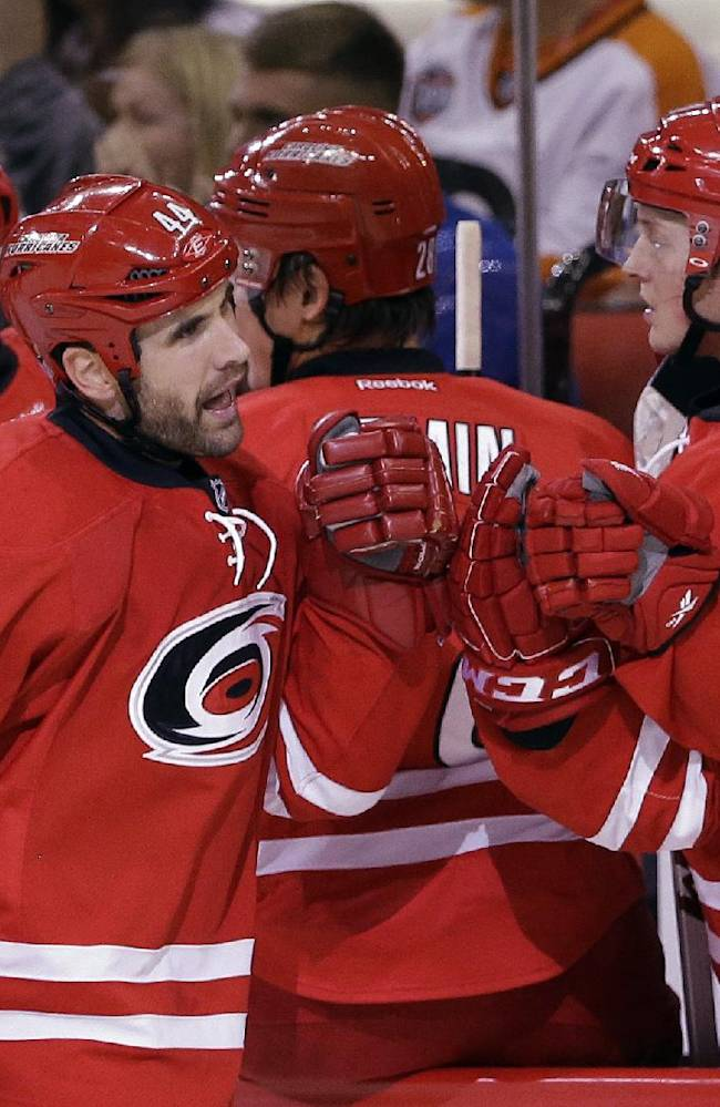 Carolina Hurricanes' Jay Harrison (44) is congratulated after scoring against the Philadelphia Flyers during the first period of an NHL hockey game in Raleigh, N.C., Sunday, Oct. 6, 2013. Carolina won 2-1