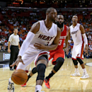 Wade leads late charge, Miami tops Houston 90-85 The Associated Press