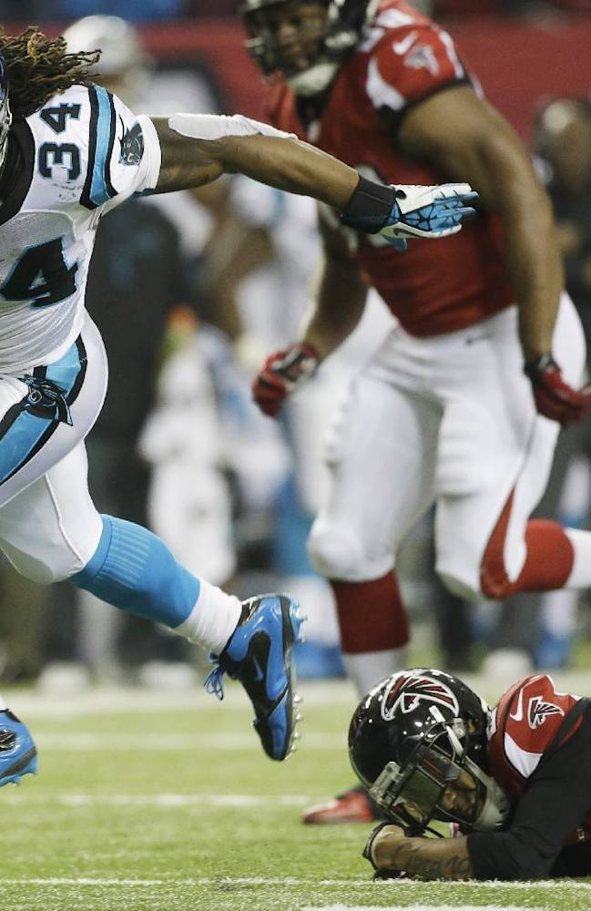 Carolina Panthers running back DeAngelo Williams (34) runs against the Atlanta Falcons during the second half of an NFL football game, Sunday, Dec. 29, 2013, in Atlanta