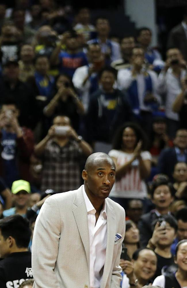 Kobe Bryant of the Los Angeles Lakers arrives onto the court during a 2013-2014 NBA preseason game between Los Angeles Lakers and Golden State Warriors at Mercedes-Benz Arena in Shanghai, China, Friday, Oct. 18, 2013