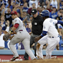 Los Angeles Dodgers' Hanley Ramirez, right, safely takes third base on a throwing error by Arizona Diamondbacks first baseman Paul Goldschmidt (not shown) as Diamondbacks third baseman Martin Prado, left, goes after the throw during the fifth inning of a