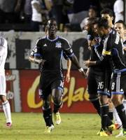 San Jose Earthquakes forward Chris Wondolowski (8) and forward Simon Dawkins (10), of England, celebrate defender Victor Bernardez, second from right, of Honduras, free kick for a goal as Los Angeles Galaxy midfielder Marcelo Sarvas (8), of Brazil, hides his face with midfielder Juninho (19), of Brazil, dejected during the extra time period of the second half of their MLS playoff soccer match, Sunday, Nov. 4, 2012, in Carson, Calif. Earthquakes won the match 1-0.  (AP Photo/Alex Gallardo)